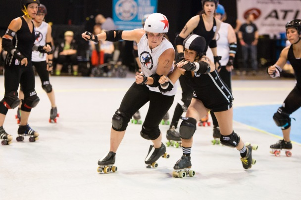 Members of the Windy City Rollers vie for position at a recent bout.  Photo by Steve Stearns.