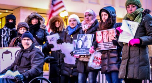 Alaa Basatneh and supporters at a recent downtown Chicago vigil to remember three Muslims killed in North Carolina. Photo by Megan Boguszko.