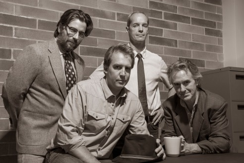 (left to right) Martin Yurek, Ryan Kitley, Mark Ulrich and Michael Joseph Mitchell in a publicity image for the world premiere of ASSASSINATION THEATER: Chicago's Role in the Crime of the Century, a theatrical investigation by Hillel Levin, directed by Kevin Christopher Fox. Photo by Michael Brosilow.