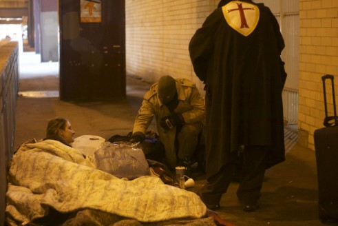 Wraith and Crusader Prime checking on a homeless person. Photo by Megan Boguszko.