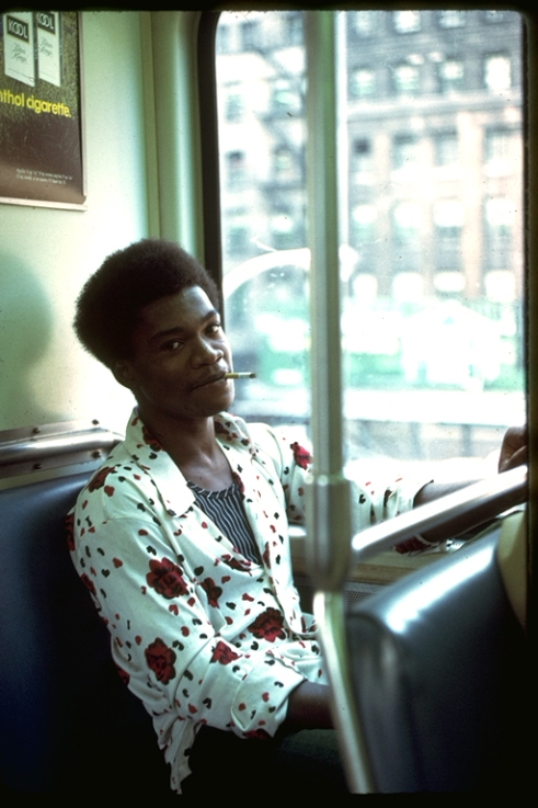 Young man smoking on the el. Photo by Tom Palazzolo. Digital image from a 35mm slide.