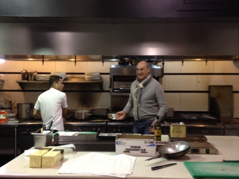 Three hours before doors open at Tocco, Abate is in the kitchen supervising.