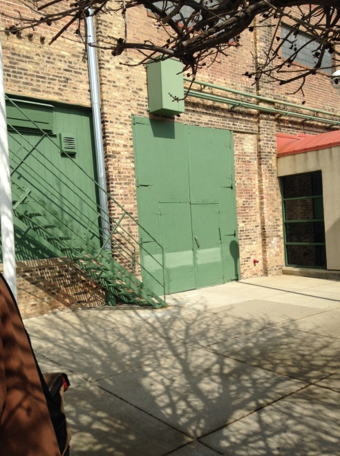 The oversized doors (to move props in and out) still exist on the outside of the old Essanay Studios building.