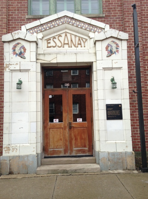 The main entrance of the long-gone Essanay Studios still bears its name and logo.