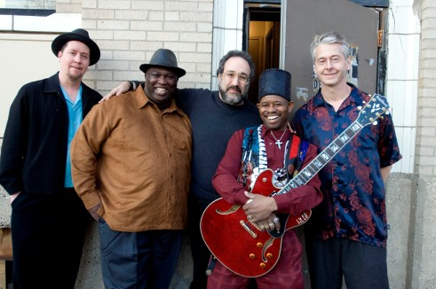 Lil' Ed & the Blues Imperials with Iglauer (center). Photo by Paul Natkin.