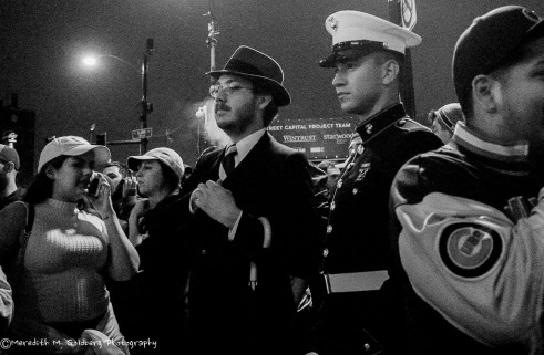 A Marine in dress uniform amongst the revelers.